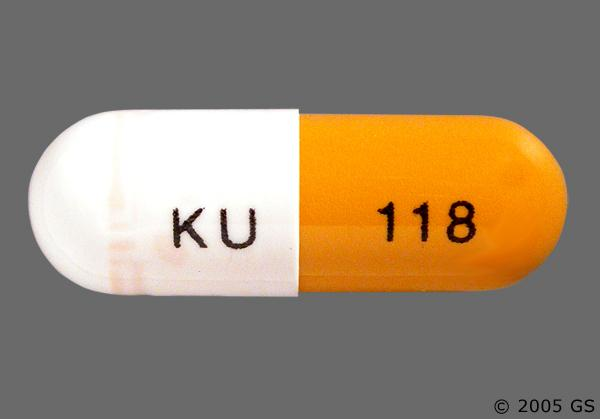 White And Yellow Ku 118 - Omeprazole 20mg Delayed-Release Capsule