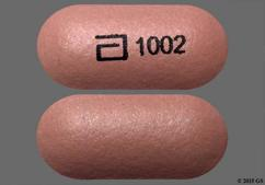 Pink Oblong Tablet Kos, 1002, And Logo 1002 - Advicor 1000mg-20mg Tablet