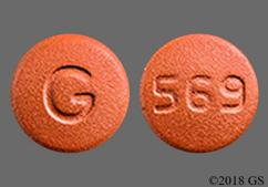 Red-Brown Round 569 And G - Amlodipine/Olmesartan Medoxomil 10mg-40mg Tablet