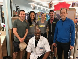 Adrian, the wonderful pharmacist at Kroger, with GoodRx team members and customers.