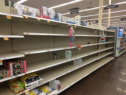 Empty shelves as supplies run low at a local Houston grocery store.